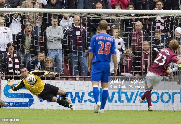Hearts' Michael Stewart scores from a penalty kick pas Rangers goalkeeper Allan McGregor during the Clydesdale Bank Scottish Premier League match at...