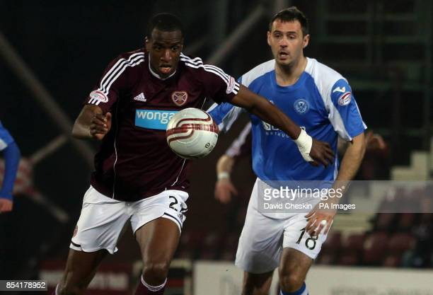 Hearts Micheal Ngoo in action with St Johnstone's David McCracken during the Clydesdale Bank Premier League match at the Tynecastle Stadium Edinburgh