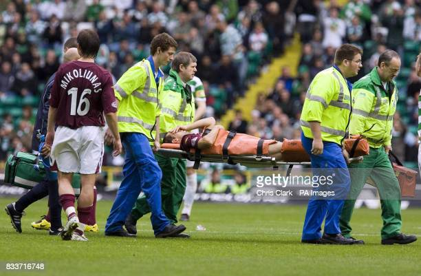 Heart's Neil McCann is carried off with an injury during the Clydesdale Bank Scottish Premier League match at Celtic Park Glasgow