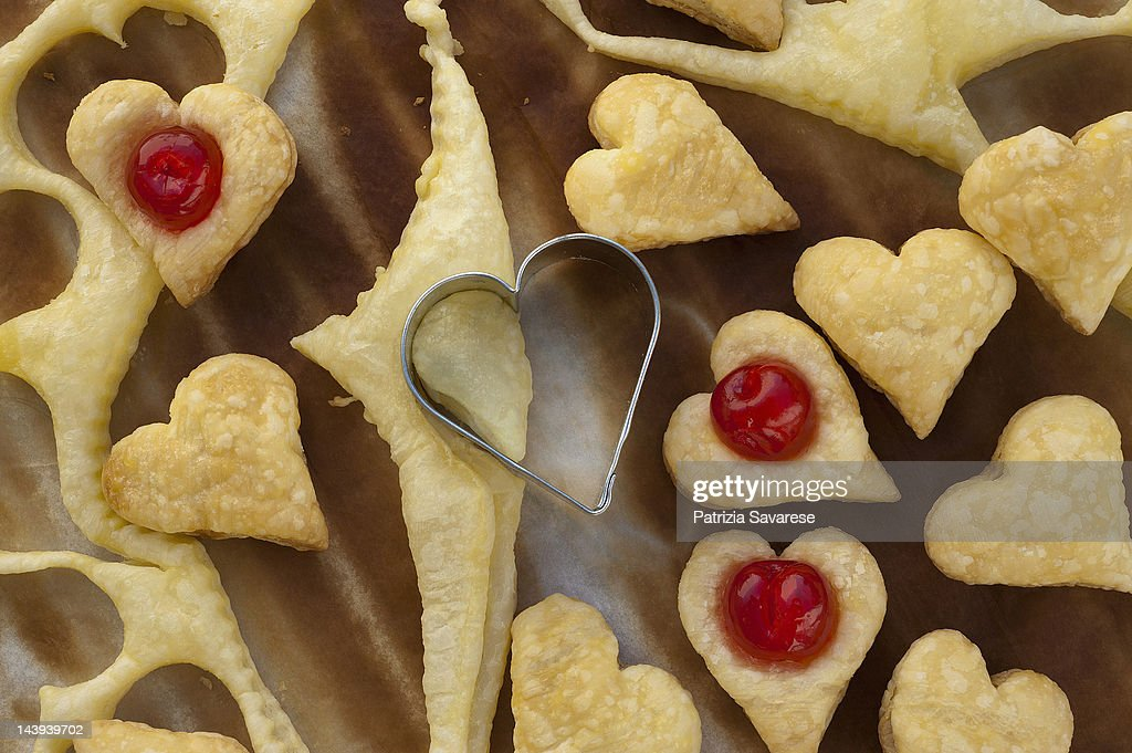 hearts of puff pastry with cherries : Stock Photo
