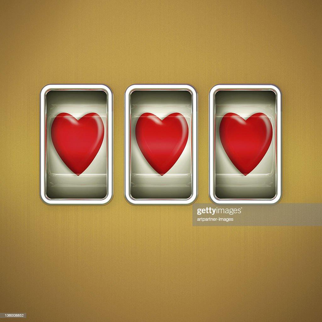 3 Hearts on a Slot Machine Display : Stock Photo