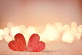Hearts on a wooden table and background is a bokeh. valentines day concept.