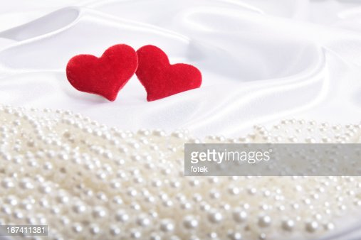 Hearts on pearls background : Stock Photo
