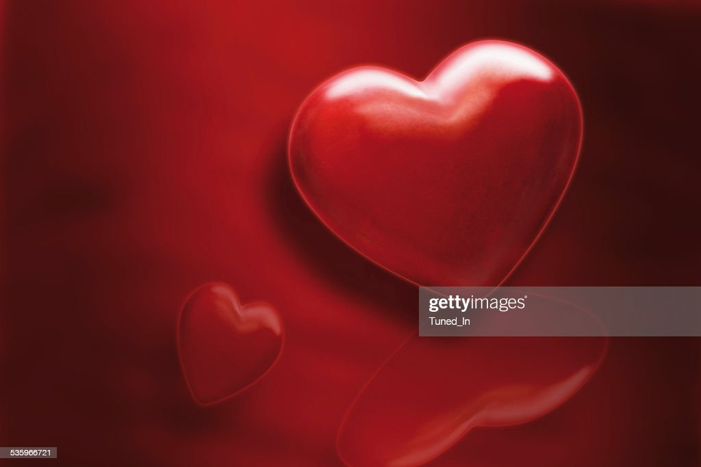 Hearts on red background, close up : Stock Photo