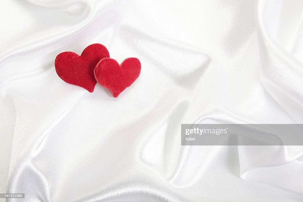 Hearts on satin Hintergrund : Stock-Foto