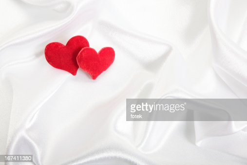 Hearts on satin background : Stock Photo