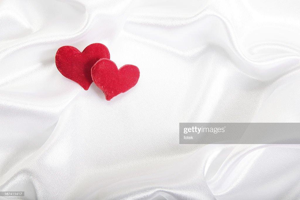 Hearts on satin background : Stock Photo