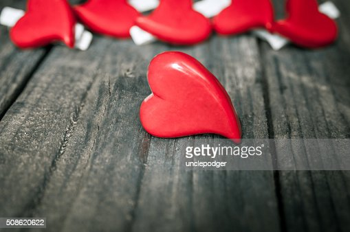 Hearts on wooden background. Valentines Day greeting card. : Stock Photo