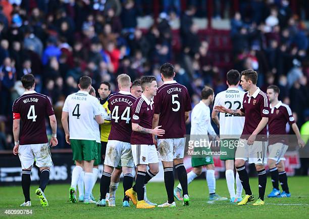 Hearts players celebrates being the only team in the UK to remain unbeaten during the Scottish Championship match between Heart of Midlothian FC and...