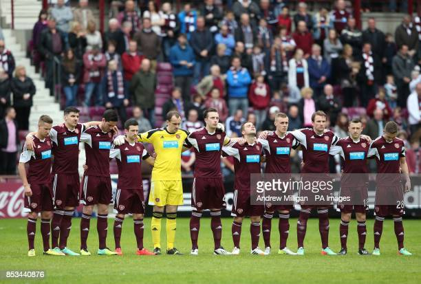 Hearts players in a minutes silence for the late Sandy Jardine before the Scottish Premier League match at Tynecastle Stadium Edinburgh
