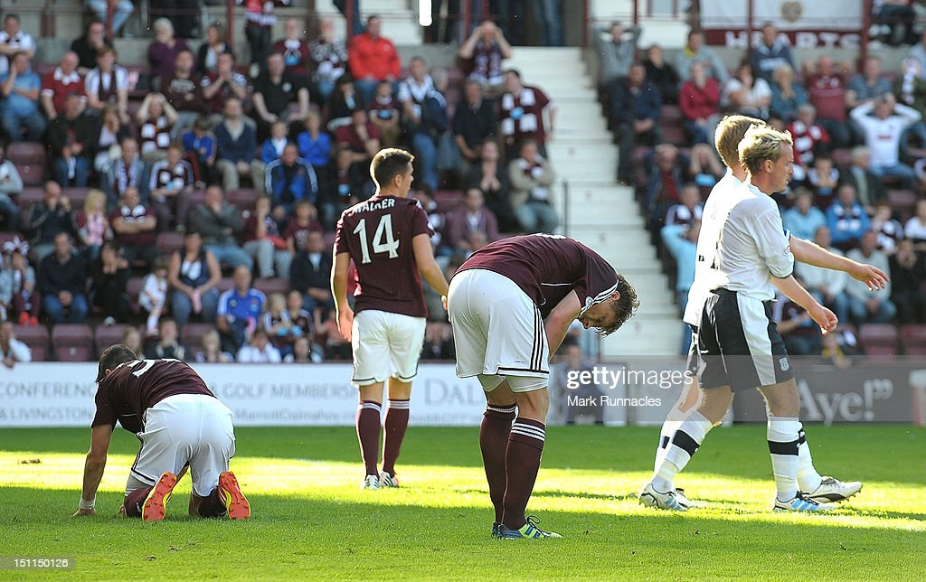 Hearts players show their dejection after missing another chance to score during the Clydesdale Bank Scottish Premier League match between Hearts and Dundee at Tyncastle Stadium on September 2, 2012 in Edinburgh, Scotland.