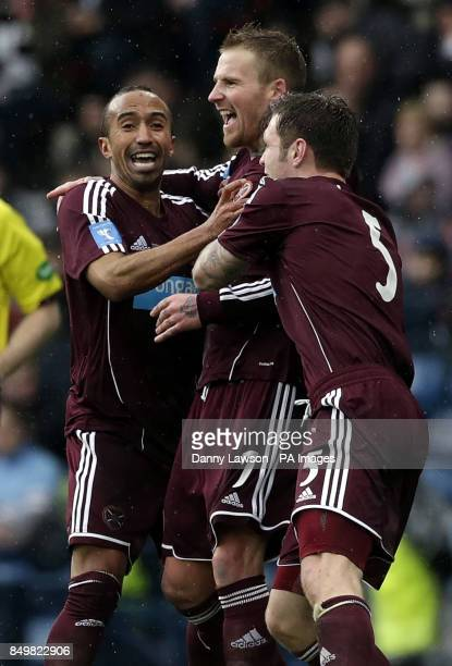 Heart's Ryan Stevenson celebrates his goal with team mates Mehdi Taouil and Darren Barr during the Scottish Communities League Cup Final at Hampden...