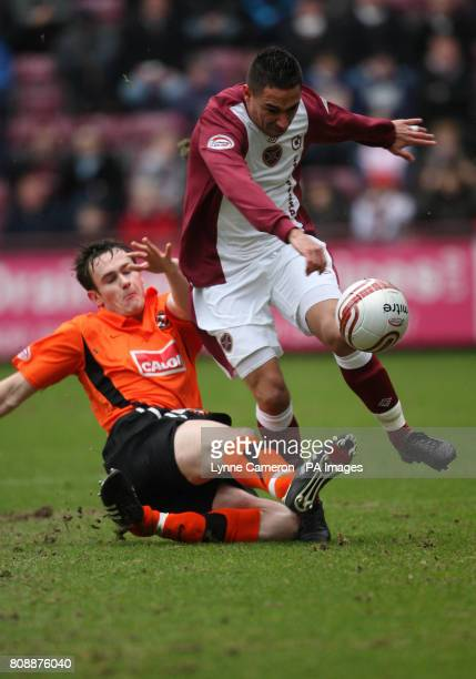 Hearts Suso Satana and Dundee United's Keith Watson during the Clydesdale Bank Scottish Premier League match at Tynecastle Stadium Edinburgh
