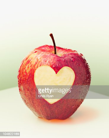 Heart-shape cut from side of red apple : Stock Photo