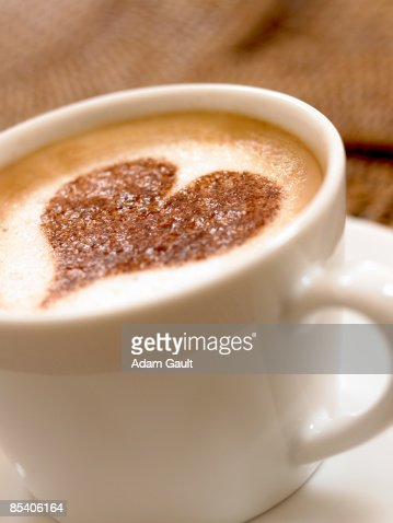 Heart-shape decoration on foam in coffee cup : Stock Photo