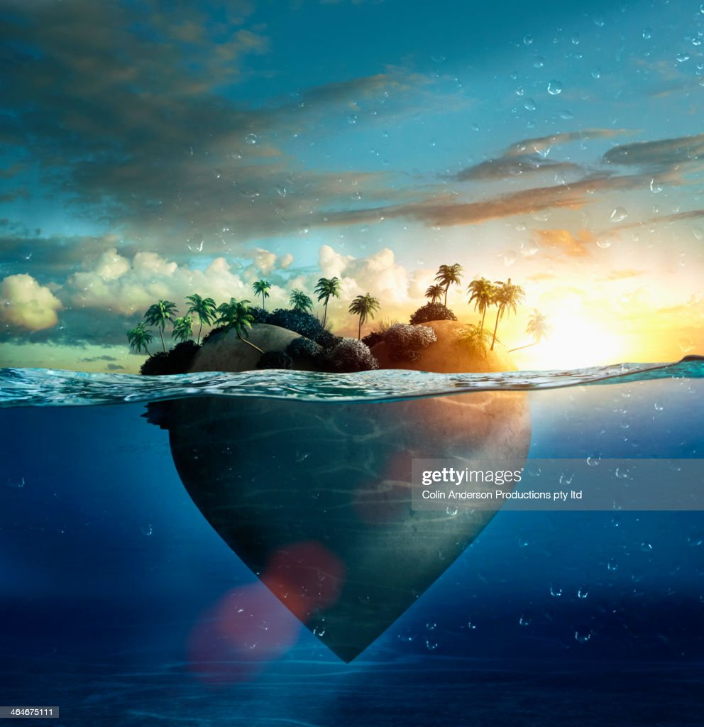 Heart-shape island floating in tropical ocean : Stock Photo