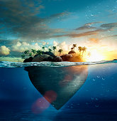 Heart-shape island floating in tropical ocean