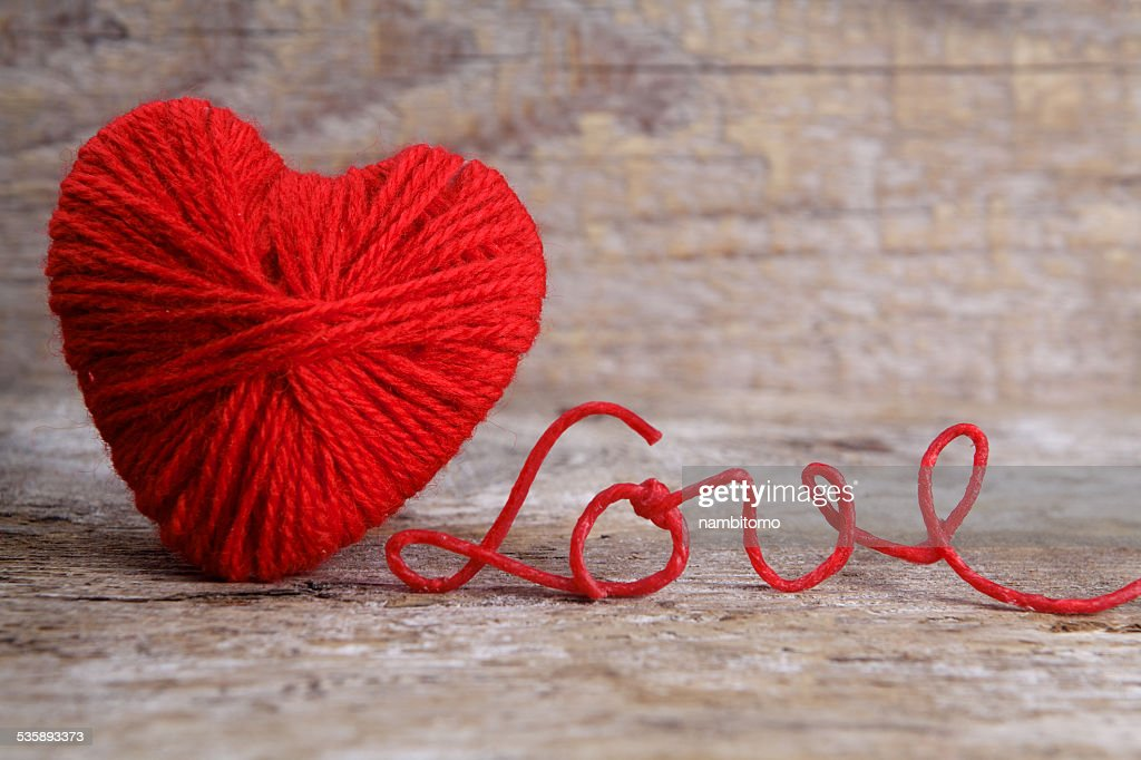 Heart-shaped ball of yarn, with words of love thread : Stock Photo
