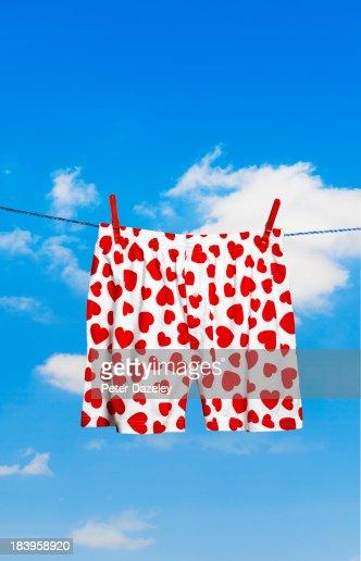 Heart-shaped boxer shorts on washing line