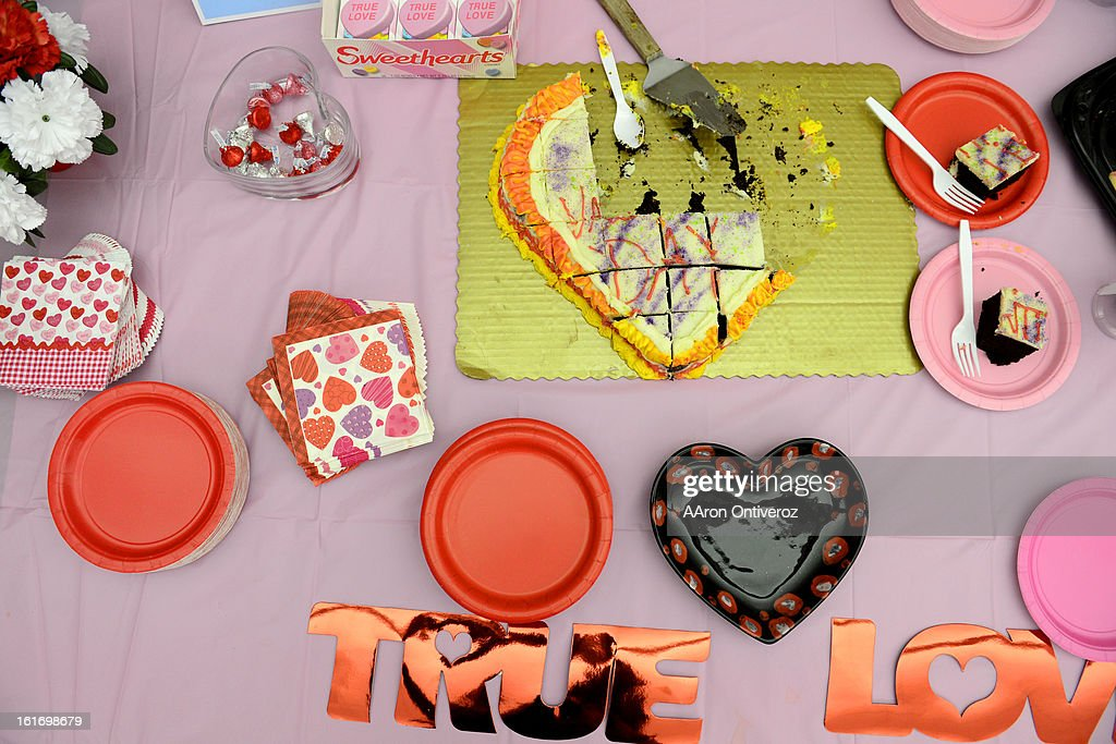 A heart-shaped cake sits half eaten on a table during a Valentine's Day marriage celebration at the Denver Clerk and Recorder's office. Couples applying for marriage licenses received gift bags containing gift certificates to local restaurants among other treats to celebrate their union.