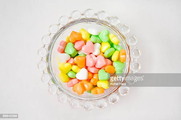 heart-shaped candies and glass bowl