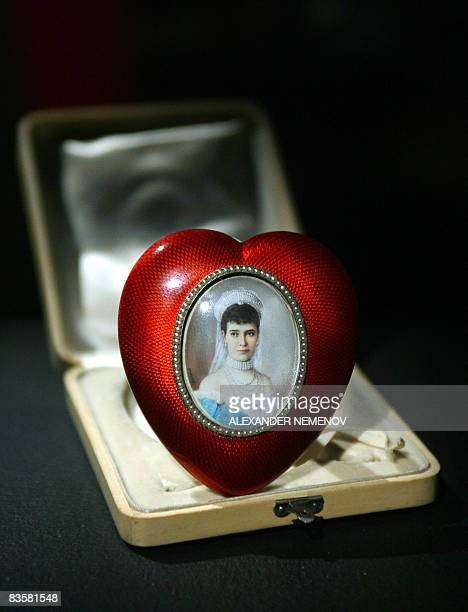 A heartshaped Faberge picture frame with a portrait of Russian Empress Maria Fedorovna sits on display in Moscow on November 6 2008 Sotheby's will...