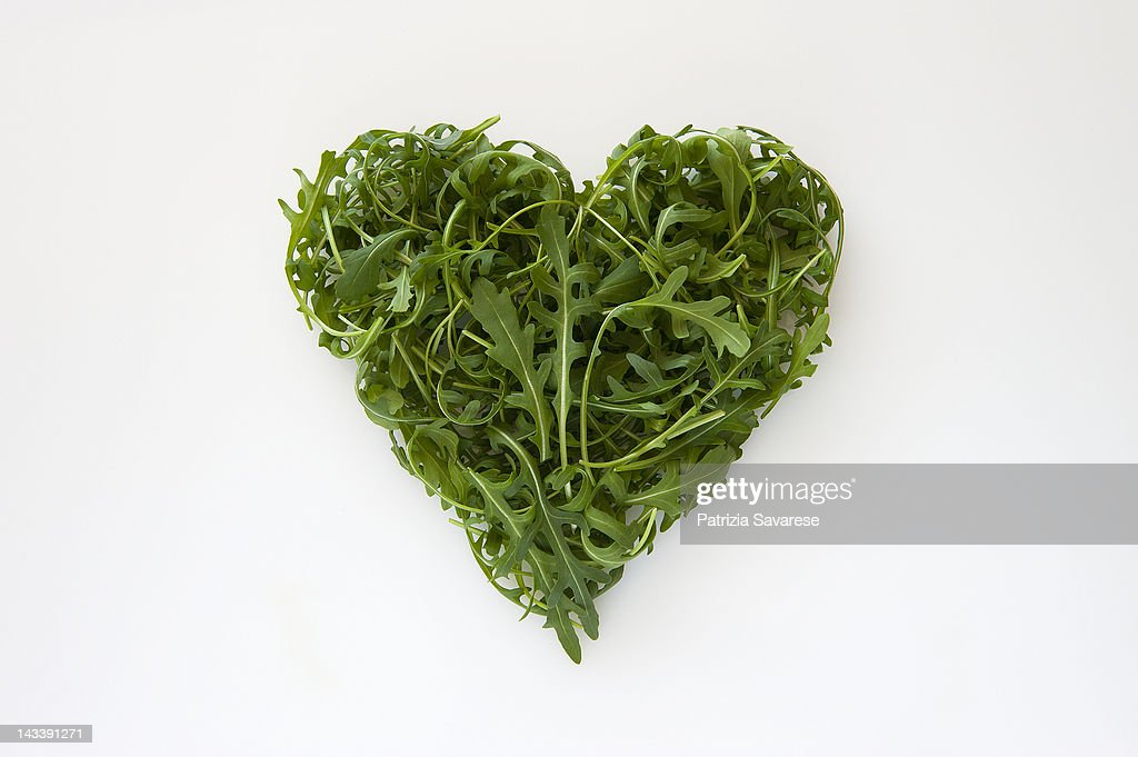 Heart-shaped formed by fresh Arugula : Stock Photo