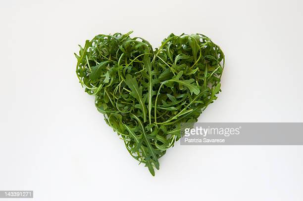 Heart-shaped formed by fresh Arugula