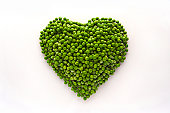 Heart-shaped formed by fresh Peas