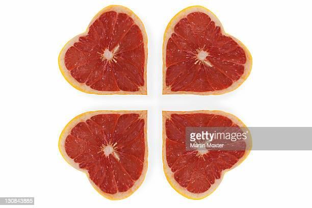 Heart-shaped grapefruits arranged as a clover leaf