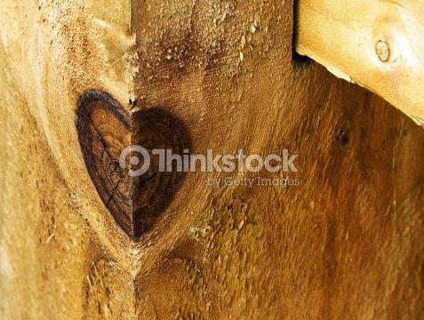 heartshaped knot in wood stock photo thinkstock
