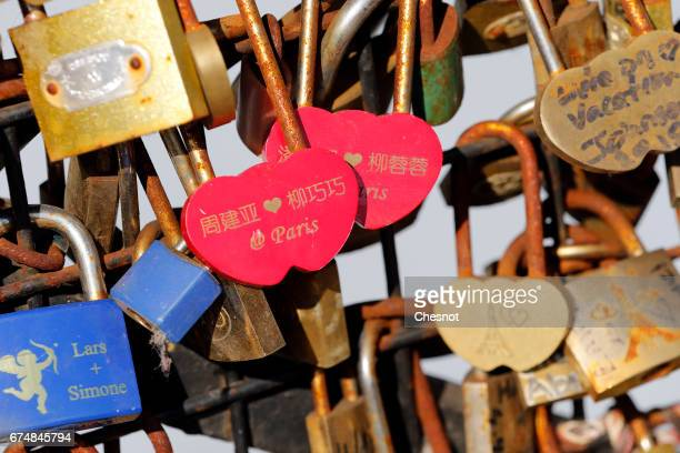 Heartshaped love padlocks are seen on the Pont Neuf on April 29 2017 in Paris France The Paris City Hall will organize on May 13th an auction of love...
