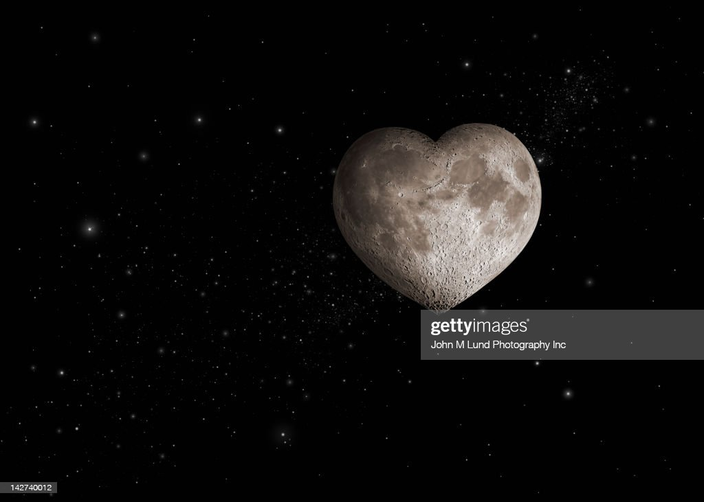 Heart-shaped moon in space : Stock Photo