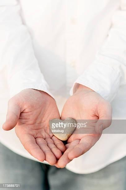 Heart-Shaped Rock in a Man's Hands