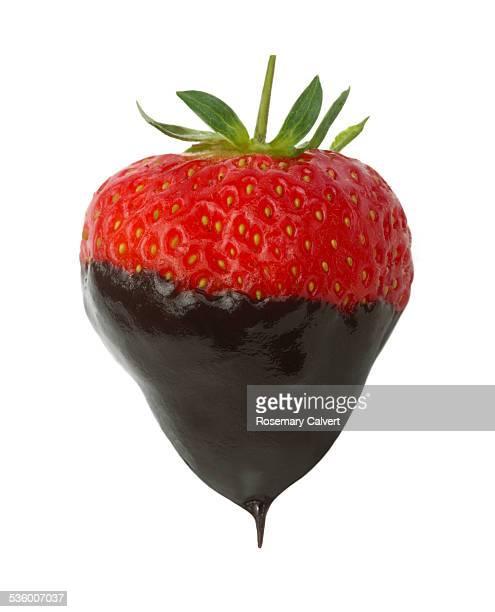 Heart-shaped strawberry drips with dark chocolate