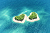 Heart-shaped tropical island in middle of the ocean and a boat going through. This is a 3d render illustration