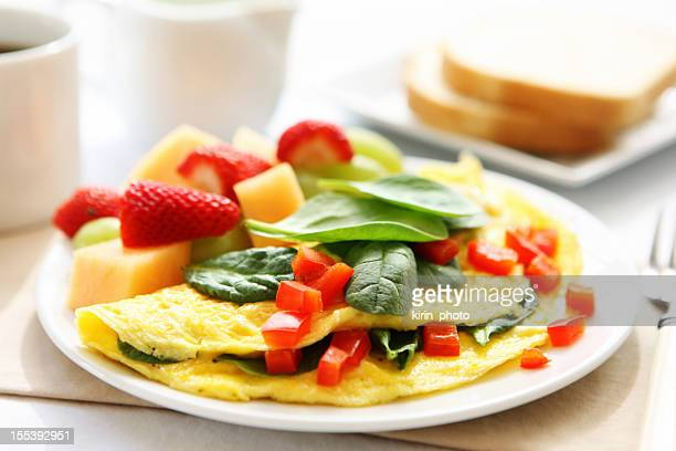 A hearty breakfast of omelet, bread and coffee