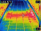 Infrared image of heated surface from underground hot water pipe. Colors represent various temperatures, defined with rainbow Celsius scale on right side of image. Temperature on upper left corner is