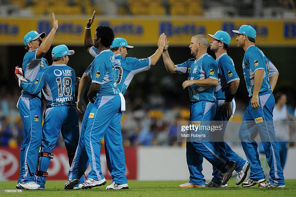 Heat players celebrate a wicket during the Big Bash League match between the Brisbane Heat and the Perth Scorchers at The Gabba on December 18, 2012 in Brisbane, Australia.