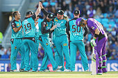 Heat players celebrate running out Ben Dunk of the Hurricanes during the Big Bash League match between Hobart Hurricanes and Brisbane Heat at...
