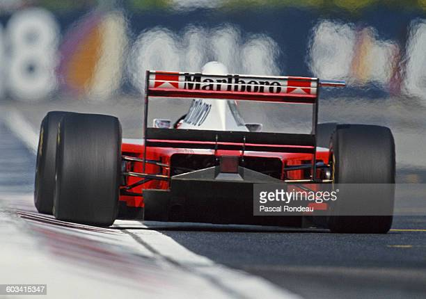 Heat shimmers from the engine as Martin Brundle of Great Britain drives the Marlboro McLaren Peugeot McLaren MP4/9 Peugeot V10 during practice for...