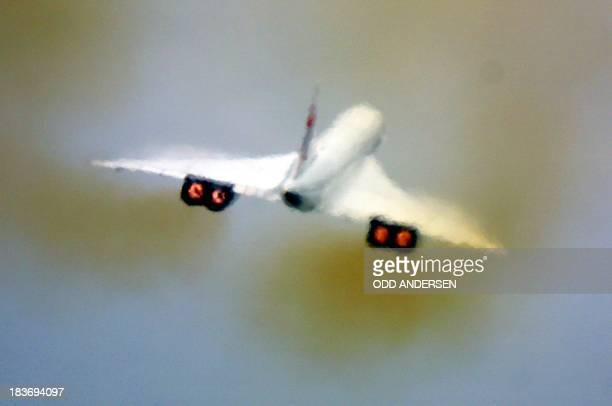 Heat waves from the jet exhausts blur the image of a British Airways Concorde after taking off from London's Heathrow enroute to New York 07 November...
