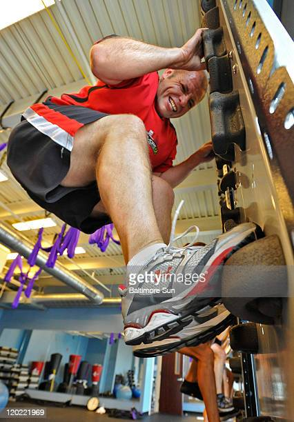 Heath Bebout participates in a 'fit wall' class for highintensity interval training at the Canton Club in Baltimore Maryland June 20 2011
