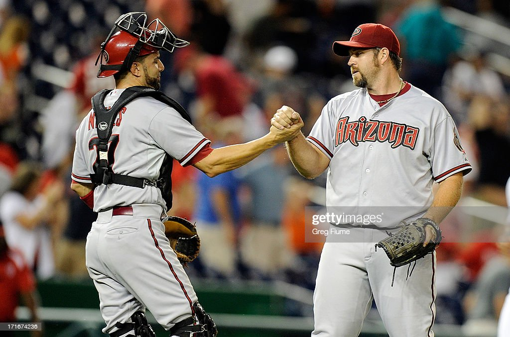 <a gi-track='captionPersonalityLinkClicked' href=/galleries/search?phrase=Heath+Bell&family=editorial&specificpeople=243211 ng-click='$event.stopPropagation()'>Heath Bell</a> #21 of the Arizona Diamondbacks celebrates with <a gi-track='captionPersonalityLinkClicked' href=/galleries/search?phrase=Wil+Nieves&family=editorial&specificpeople=835752 ng-click='$event.stopPropagation()'>Wil Nieves</a> #27 after a 3-2 victory against the Washington Nationals at Nationals Park on June 27, 2013 in Washington, DC.