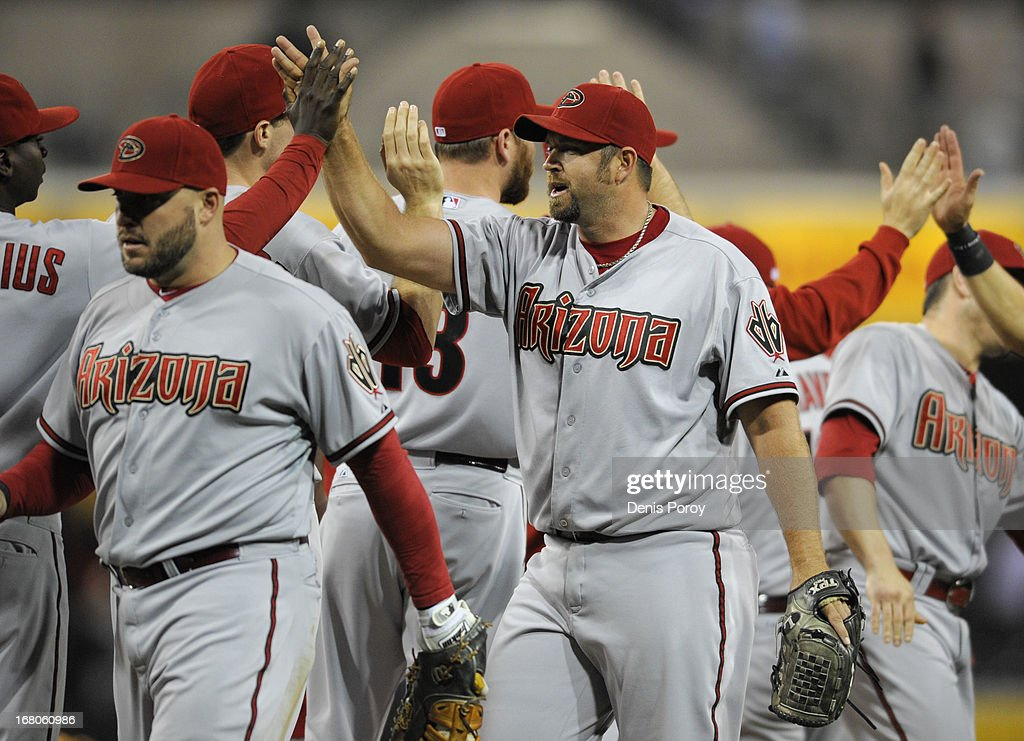 <a gi-track='captionPersonalityLinkClicked' href=/galleries/search?phrase=Heath+Bell&family=editorial&specificpeople=243211 ng-click='$event.stopPropagation()'>Heath Bell</a> #21 of the Arizona Diamondbacks, center, high-fives teammates after the Diamondbacks beat the San Diego Padres 8-1 in a baseball game at Petco Park on May 4, 2013 in San Diego, California.