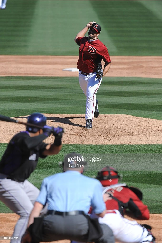 <a gi-track='captionPersonalityLinkClicked' href=/galleries/search?phrase=Heath+Bell&family=editorial&specificpeople=243211 ng-click='$event.stopPropagation()'>Heath Bell</a> #21 of the Arizona Diamondbacks pitches during the game against the Colorado Rockies on February 23, 2013 at the Salt River Fields at Talking Stick in Scottsdale, Arizona. The Rockies defeated the Diamondbacks 11-2.