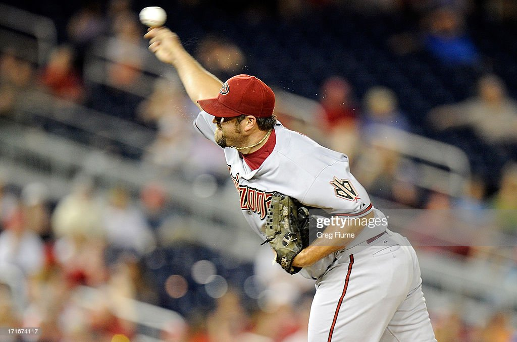 <a gi-track='captionPersonalityLinkClicked' href=/galleries/search?phrase=Heath+Bell&family=editorial&specificpeople=243211 ng-click='$event.stopPropagation()'>Heath Bell</a> #21 of the Arizona Diamondbacks pitches in the eleventh inning against the Washington Nationals at Nationals Park on June 27, 2013 in Washington, DC.