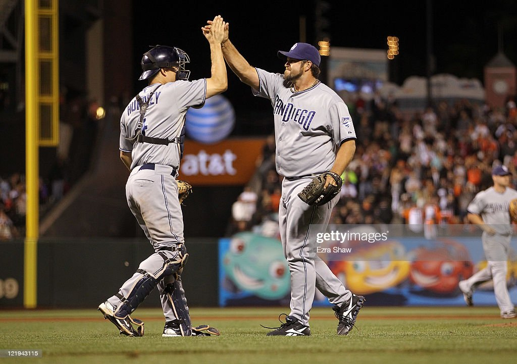 <a gi-track='captionPersonalityLinkClicked' href=/galleries/search?phrase=Heath+Bell&family=editorial&specificpeople=243211 ng-click='$event.stopPropagation()'>Heath Bell</a> #21 of the San Diego Padres is congratulated by <a gi-track='captionPersonalityLinkClicked' href=/galleries/search?phrase=Nick+Hundley&family=editorial&specificpeople=4175399 ng-click='$event.stopPropagation()'>Nick Hundley</a> #4 after the Padres beat the San Francisco Giants at AT&T Park on August 23, 2011 in San Francisco, California.