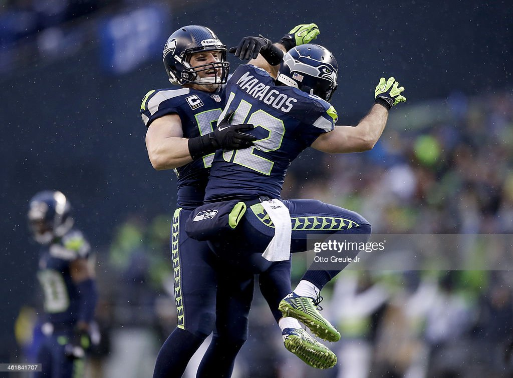 Heath Farwell #55 and free safety Chris Maragos #42 of the Seattle Seahawks celebrate in the fourth quarter while taking on the New Orleans Saints during the NFC Divisional Playoff Game at CenturyLink Field on January 11, 2014 in Seattle, Washington.