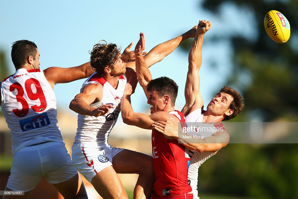 Heath Grundy, Dane Rampe and Nick Smith (far right) of the White Team spoil the mark of Dean Towers of the Red Team during the Sydney Swans AFL intra-club match at Henson Park on February 12, 2016 in Sydney, Australia.